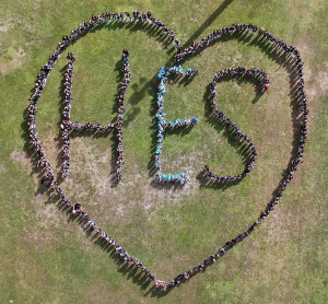 Drone Shot of Students forming heart and spelling HES